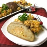 Vegan turkey roast with vegan stuffing on white plate