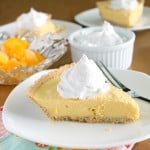 vegan mango cream pie on white plate with fork