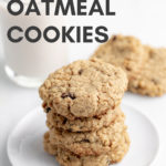 vegan oatmeal cookies on white plate with white background with text overlay for Pinterest