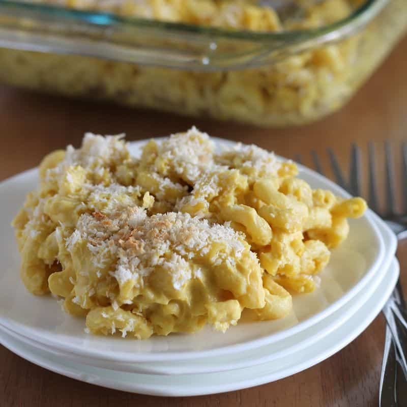 vegan cauliflower Mac and cheese on small white plate with wooden table background