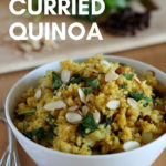 vegan curried quinoa in white bowl with chopped cilantro in background with text overlay