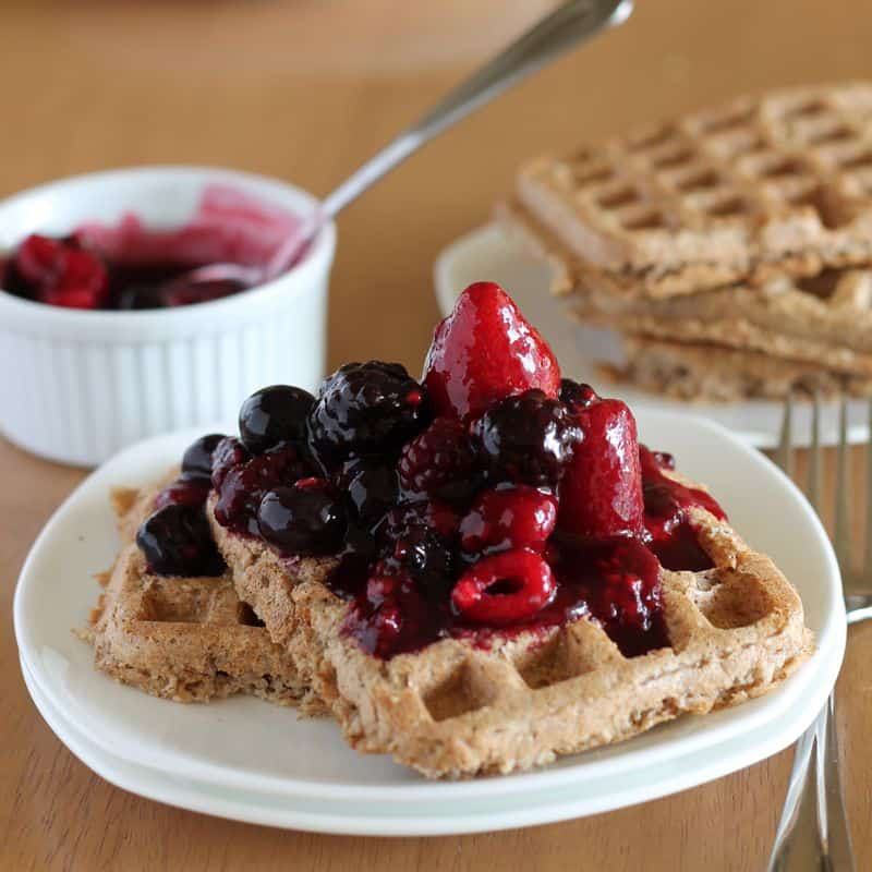 healthy vegan waffles on white plate with wood background