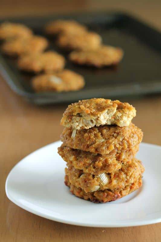 stack of vegan quinoa tofu patties on white plate with wooden background