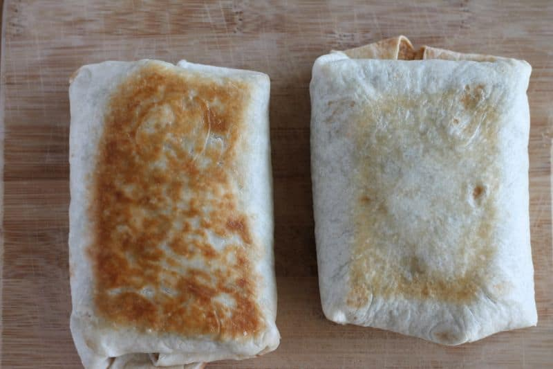 2 chimichangas side by side demonstrating difference between pan-fried (darker and crunchier) versus oven-baked