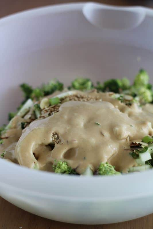 unmixed broccoli cucumber salad with Asian style dressing on top