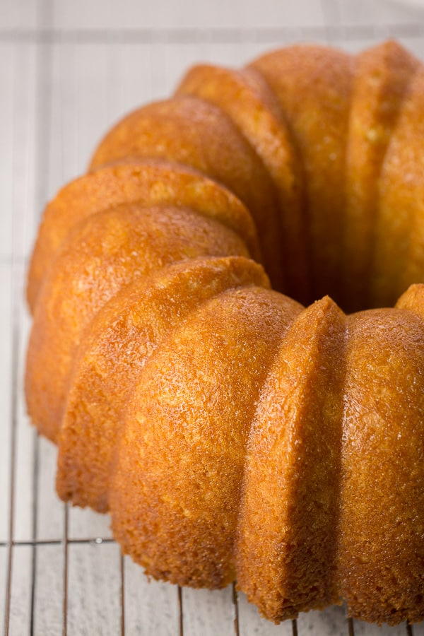 vegan lemon bundt cake cooling on cooling rack