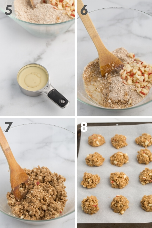 oil and milk in a measuring cup, unmixed wet and dry ingredients for cookies in a glass bowl with wooden spoon and marble background, cookie dough mounds on lined cookie sheet